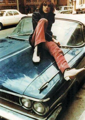 Syd Barrett on a Pontiac Parisienne, 1969.